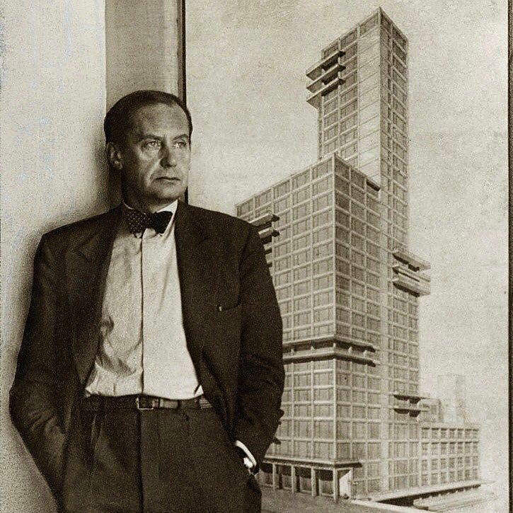 Walter Gropius stands in front of a competition entry that he and with Adolf Meyer made for the Chicago Tribune tower in 1922. #TBT