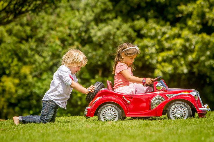 How To Have A Successful Picnic With A Toddler In Tow - Kamo - young happy children - boy and girl - driving a toy car at a picnic in park