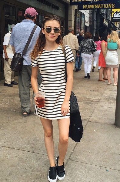 Adorable outfit! Black and white striped dress and perforated leather vans slip-ons.