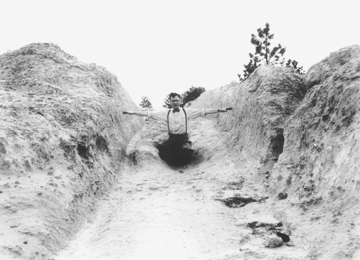 A man shows the width of the Oregon Trail, between 1920 and 1930