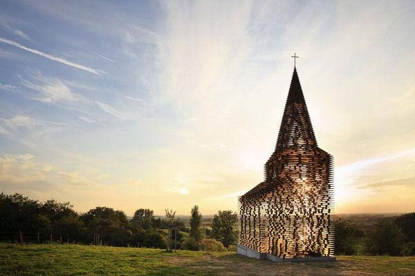 From inside theGijs Van Vaerenbergh-designed art church known as Reading Between The Lines the natural sunlight hits the ground in a noiris...