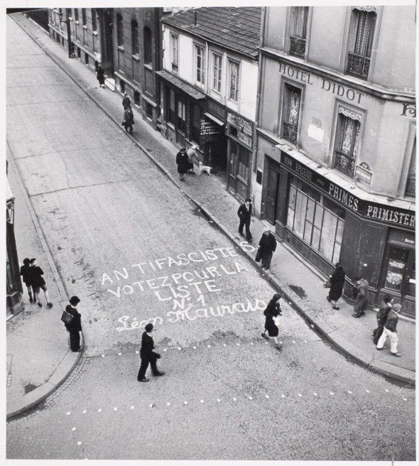 Robert Doisneau  //  Due to paper rationing for election publicity, communist candidate Leon Maurais chalked onto a street in his political district during first postwar elections, France], 1945