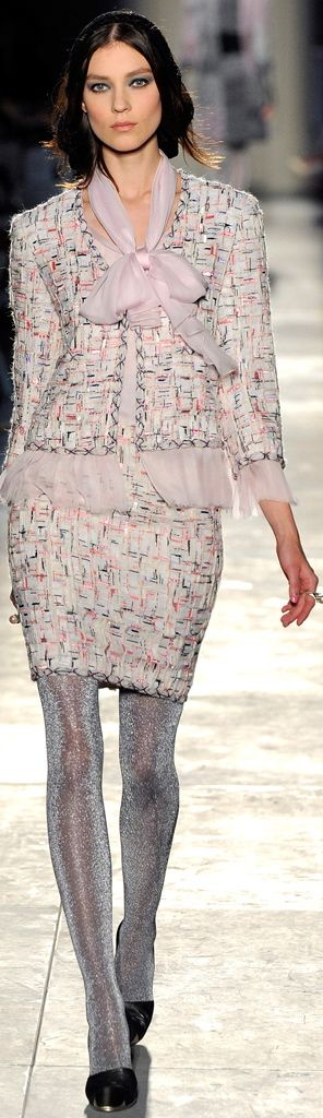 Chanel. Aside from the disturbingly thin legs of the model, I like the chiffon edges to the jacket.