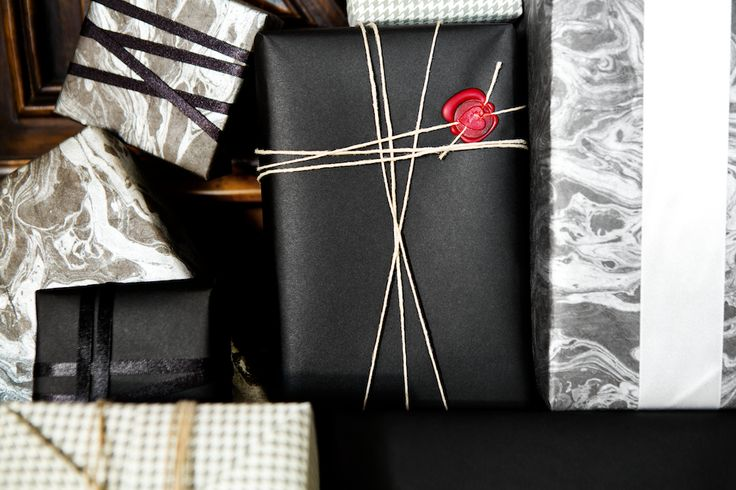 black and white marbled wrapping paper with asymmetrical ribbon and wax seal // gift wrapping ideas