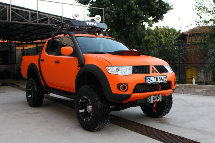 Mitsubishi L200 Orange. This is my dream. Add Golden Retrievers in it and voila! Perfect for me :)