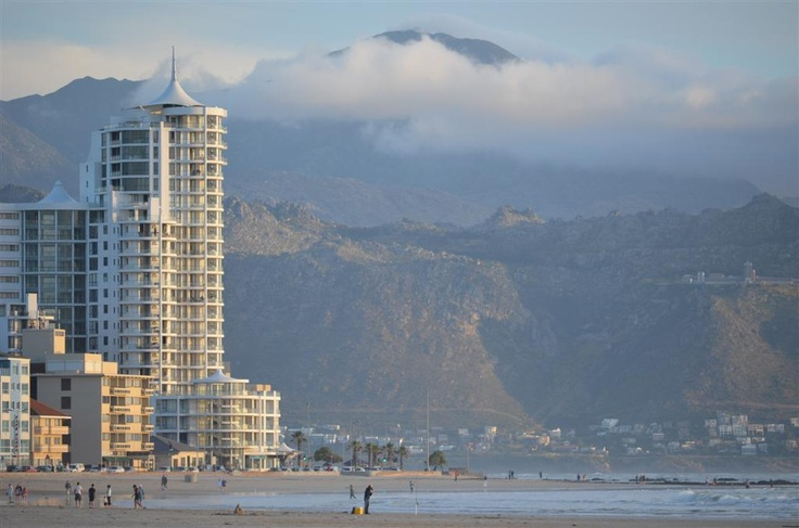 Hibernian Towers in Strand on Beach Road - Gordon's Bay (and the Suikerbossie Street area) as backdrop against the Hottentots-Holland mountain range. Steenbras dam viewpoint also visible higher up the mountain....this is one of those spots you have to see with your next visit to the Helderberg.
