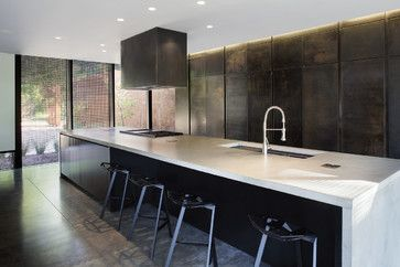 Heavy Metal contemporary kitchen - blackened steel cabinets. Full wall of cabinets, stone waterfall on island.