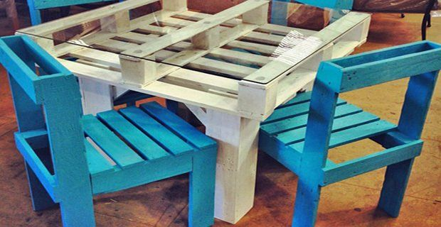 A table and colorful chairs made by recycling pallets.