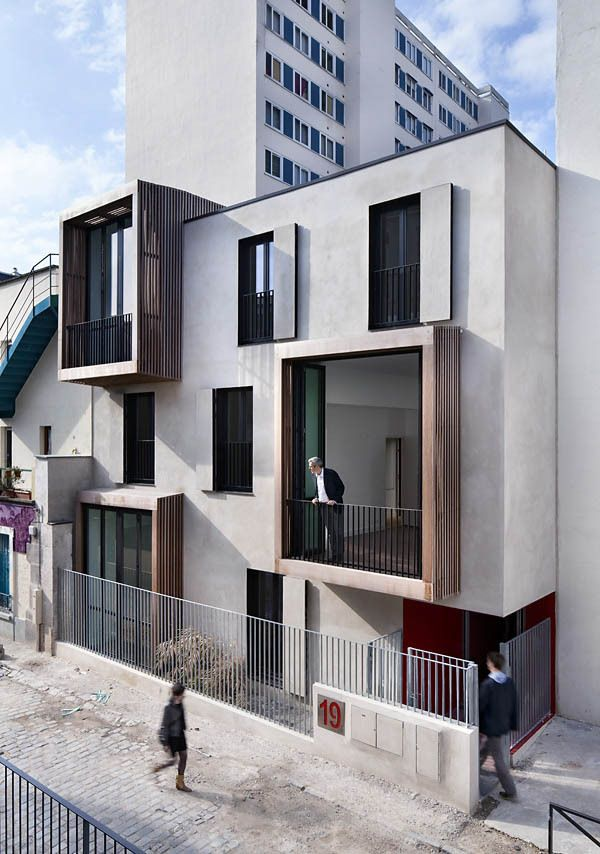 lovely protruding exterior grids -Tetris, social housing and artist studios / Moussafir Architectes