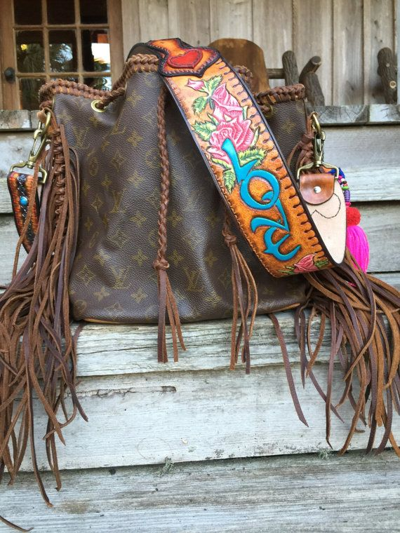 VINTAGE SWAG Boho-Inspired Vintage Louis Vuitton Noe Petit. Custom tooled and painted strap. Boho tassel charm. Different straps and charms available. Check out our other styles at www.vintageswag.co Everyone is talking about JoJos (The Bachelor) and our JoJo bag is featured in PEOPLE MAGAZINE. VINTAGE SWAGS Vintage Louis Vuitton Saint Cloud GM was custom made for JoJo. Layaway available. Custom made to order. Strap and charm may vary. All sales final. Ships in 2-4 weeks. Follow us on…