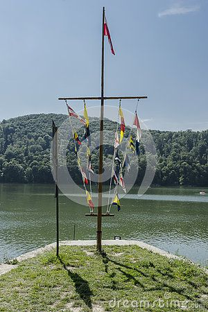 Stand with the flags of sailing yacht on the Lake in Roznow , Poland.