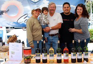 Steve Gliessman and his wife Robbie Jaffe, son Erin, his wife Oriana, and Mateo at the Westside farmers' market in Santa Cruz.