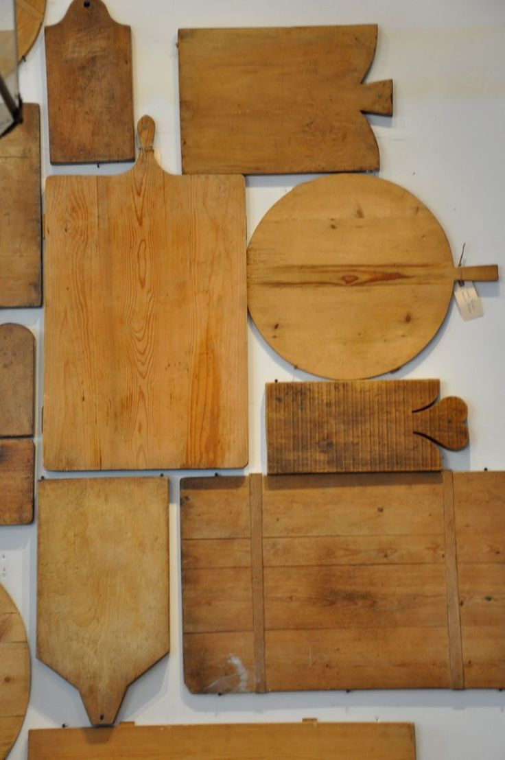 Antique breadboards. Reminds me of my German grandmother - sometimes we'd eat a sandwich lunch off of these. It was almost like picnicking! Joy