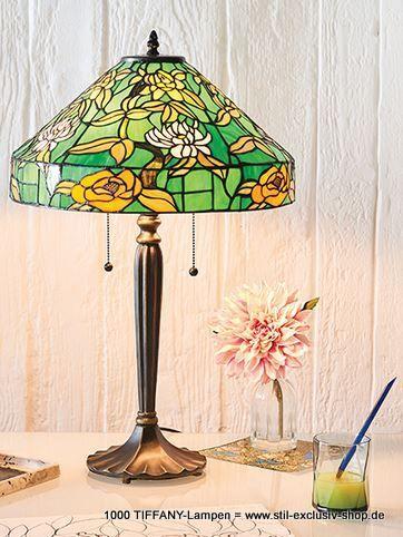 40cm ø TIFFANY-Tisch-Lampe, unsere Serie AGAPANTHA.   ohne Dekoration !  40cm ø.  2 x E-27 40W ca. 63 cm hoch.           mit praktischer Zug-Schaltung !  ...besticht durch ein florales Design in orange und gelb auf einem leuchtend grünen Hintergrund, kombiniert mit einem bronzefarbenen Effekt.