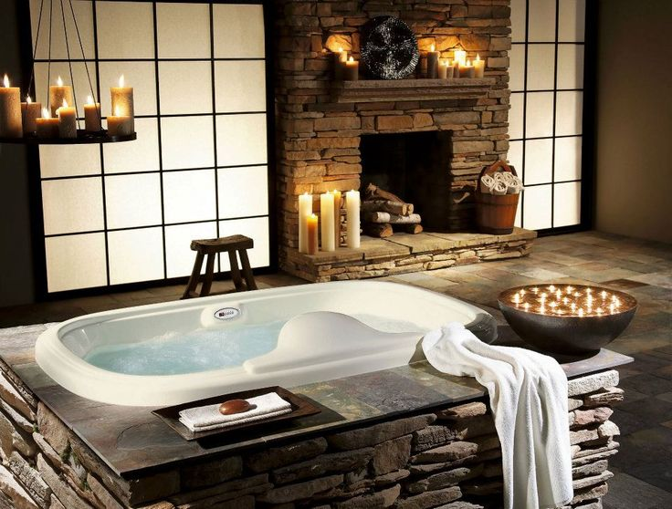 love the bowl of floating candles, hanging candles and soap dish!! romantic bathroom