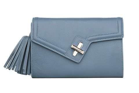 Mini MILCK Clutch Classic in blue. Small, but not too tiny, this fulfills all the basic clutch duties. Meanwhile, the chain strap  gives it the versatility to sling crossbody and worn with a bit of edge.