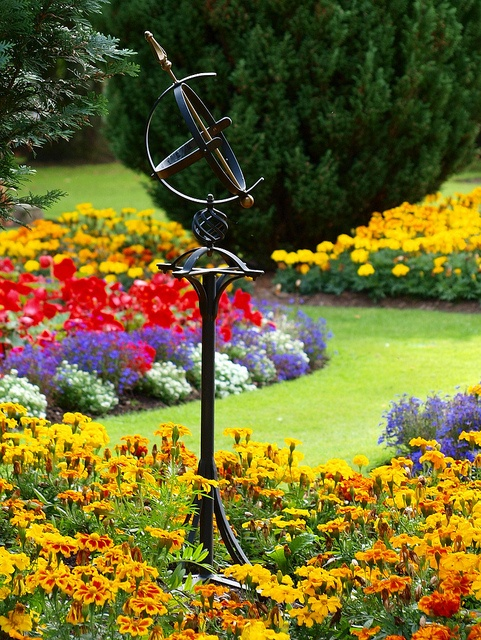 Sundial surrounded by marigolds and more...