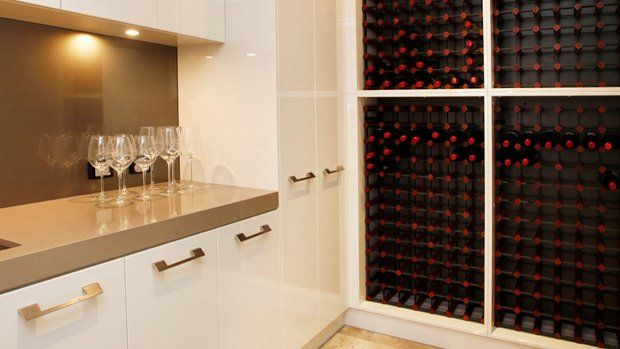 The wine cellar and butlers pantry sit adjacent to the kitchen for easy entertaining...