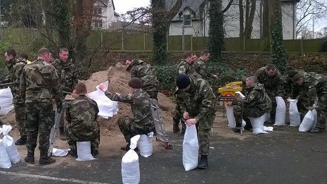 Troops from the 12th Battalion fill sandbags for flood defences (Pic: Defence Forces)