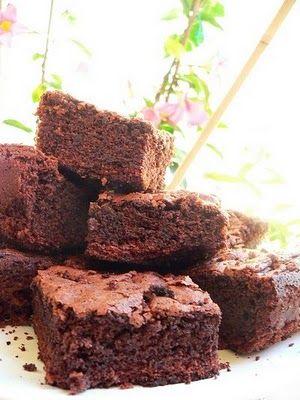 chocolate brownies,  - 150 g Butter  - 150 g Dark Chocolate  - 150 g Sugar  - 80 g Flour  - 3 Eggs  - 40 g Milk  - 1 Spoon Unsweetened Cocoa Powder  - 1 Baking Powder Sachet