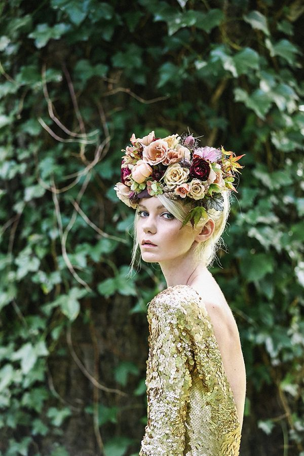 Lush floral crown paired with a goldsequined gown from