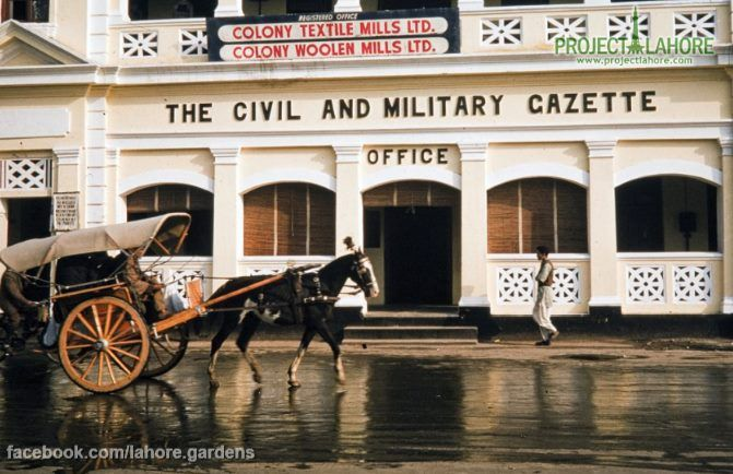A tonga rolling past one of the former British Raj buildings in Lahore, one of the settings for my current work in progress, VEILED AT MIDNIGHT, to be released Aug. 2014