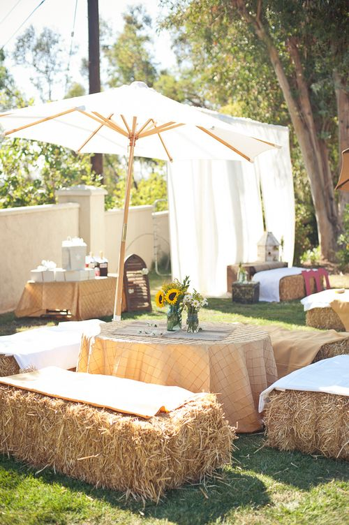 Using hay bales for outdoor seating--great for a fall wedding reception!