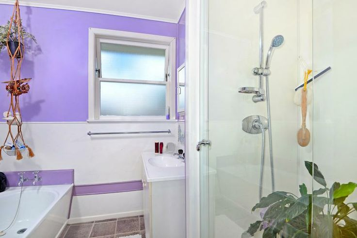 Magnificent mauve bathroom of 1960's weatherboard home @ Archers Rd, Glenfield. Original bath and window, railing and sink, taps. But new glass shower and lino. (in Mar 2014)