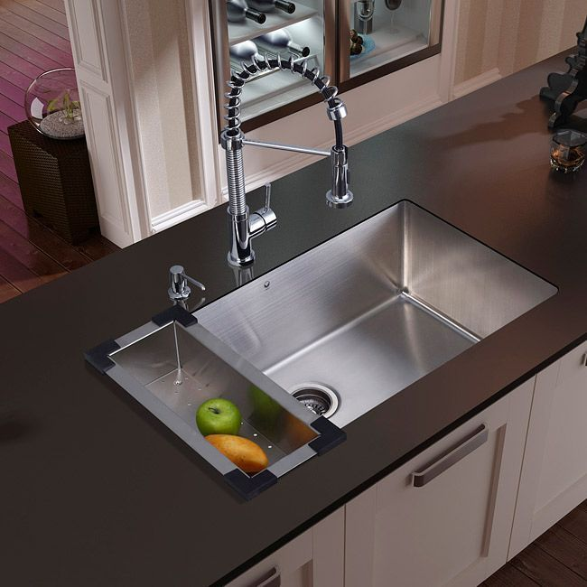 The Vigo single bowl, farmhouse kitchen sink complements any decor and is highly functional. Sink Sink type: Kitchen Sink style: Undermount Sink material: 16 gauge 304 series stainless steel Exterior