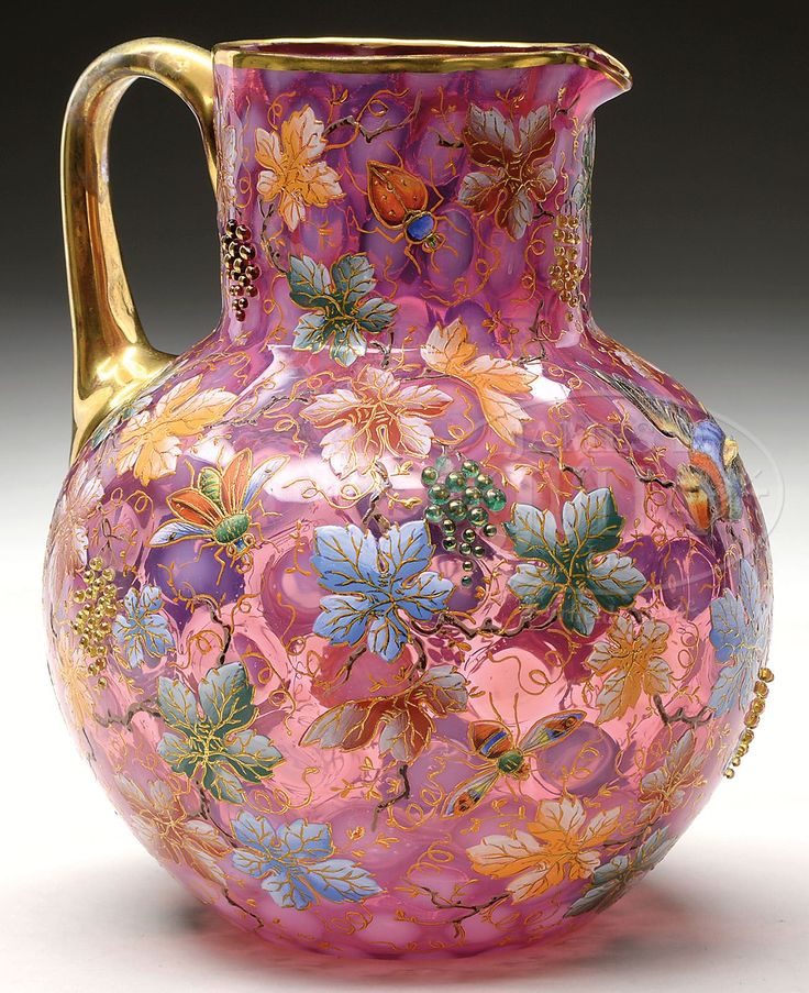 Moser Opalescent Decorated Cranberry Glass Pitcher Has Opalescent Coin Spot Pattern And Is Decorated With Allover Brightly Enameled Grape Leaves And Gilded Vines With Applied Beaded Grapes, Three Dimensional Applied Birds And Numerous Enameled Insects, Finished With A Gilded Applied Glass Handle  -  James D. Julia, Inc. Auctioneers