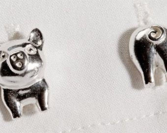 Pig cufflinks with a twist in Sterling Silver