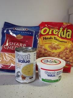 Hashbrown Casserole.  cheddar cheese, cream of chicken soup, sour cream, frozen hash browns