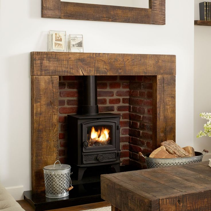 25 best ideas about fire surround on pinterest wood for Wood fireplace surround designs