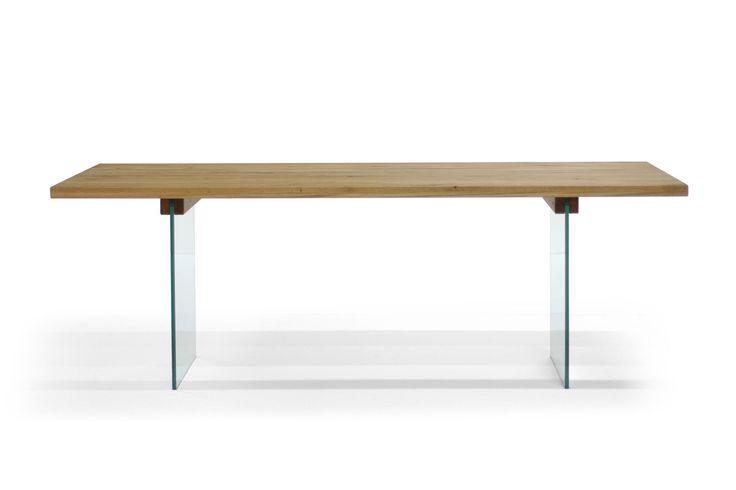 Filigraner Massivholz Esstisch mit speziellem Glasgestell, fügt sich perfekt in jede Wohnsituation ein. Durch das Glasgestell wirkt die Massivholz Tischplatte schwebend.