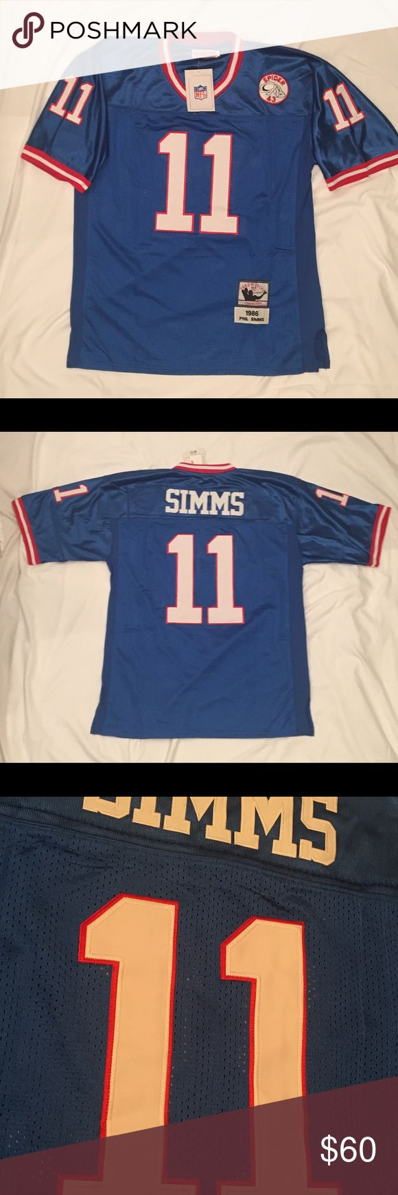 Phil Simms 1986 Throwback Jersey Great Phil Simms 1986 Throwback Jersey. Rare! Stitched. Great material! Size Large Shirts
