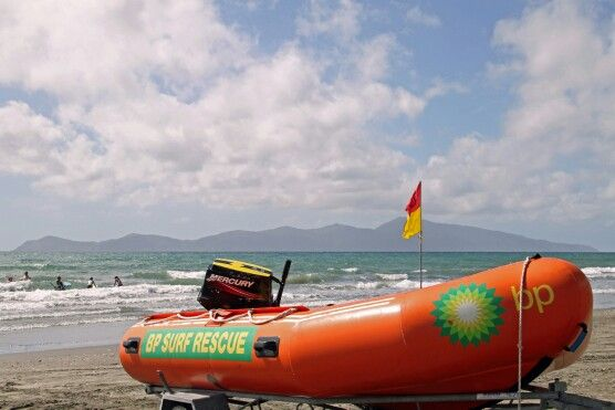 Surf rescue boat at Paekakariki beach with Kapiti Island, NZ.