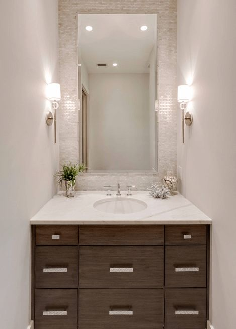 Dark Wood Vanity And Shiny White Tiles - Off-white tile reflects the light from the sconces in this small bathroom