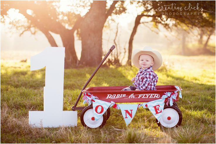 little boy and his red wagon | 1 year birthday shoot | radio flyer wagon | www.creativeclicksphoto.com