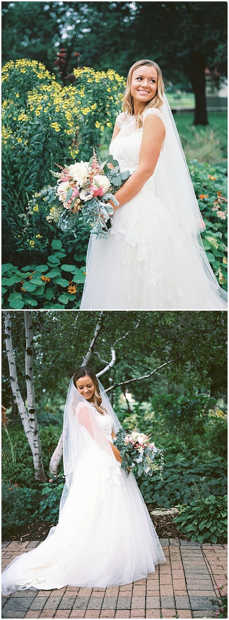 Inside the bouquet: Blush ranunculus, anemones, silver brunia, dahlias, blush astilbi, guinea eucalyptus, silver dollar eucalyptus, dusty miller, scabiosa, snapdragons, seeded eucalyptus, white freesia, protea, and white Veronicas. Floral designed by Minneapolis wedding florist Artemisia Studios. Photos by @marcandreophoto #dayblockeventcenter #bride #bridalbouquet #Bouquet #flowers #floral #florist #summerwedding #weddingflowers #minneapolisweddingflorist #artemisiastudios