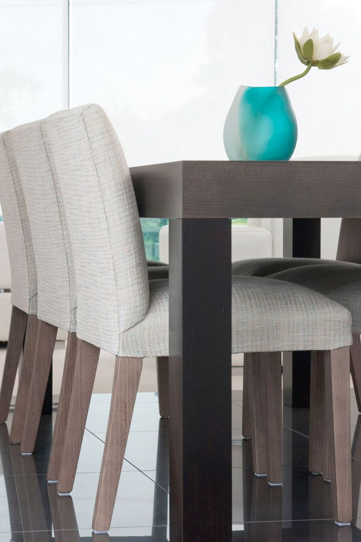 Emme Designs custom upholstered dining chair in a natural colourway fabric.