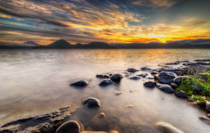 Photo Lake Toya morning light by Randy  on 500px