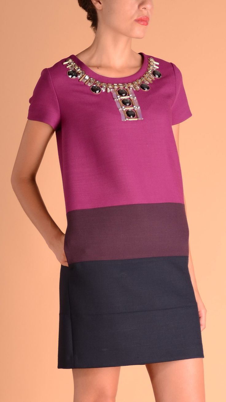 Short sleeve crew neck dress featuring front jewel details, two welt pockets, concealed zip fastening. 53% polyester, 43% pure wool, 4% elastane. Size 46.