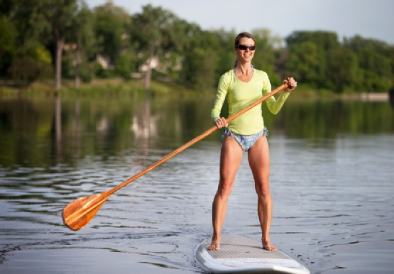 Sexy girl Stand Up Paddle Boarding. Wooden Paddle SUP. 2 Stand Up Guys Paddle Board Lessons & Sales 1701 Tamarack Ave Carlsbad, Ca 92008 (347)489-3926
