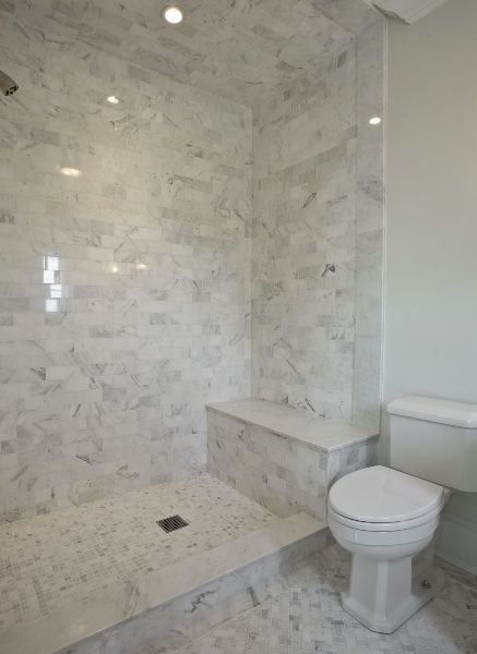 marble basketweave floor | marble mosaic & subway tile shower