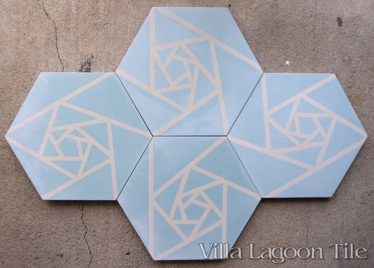 Origami Blue hex cement tile, on the warehouse floor.