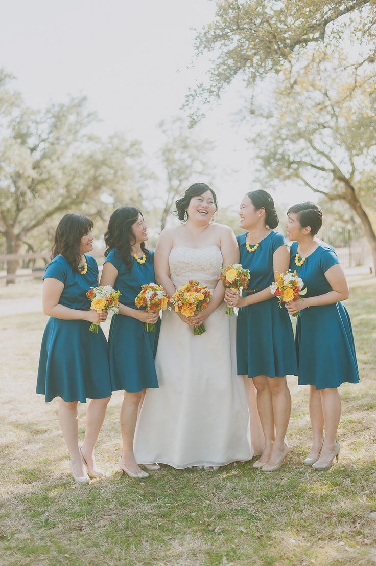 Blue and yellow bridesmaids | Photography: Day 7 Photography - www.day7photography.com  Read More: http://www.stylemepretty.com/2014/05/29/despicable-me-themed-wedding/