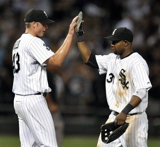 Chicago White Sox closing pitcher Addison Reed, left, celebrates with teammate Alejandro De Aza right, after defeating the Minnesota Twins 4-2 during a baseball game in Chicago, Monday, Sept. 3, 2012. (AP Photo/Paul Beaty)