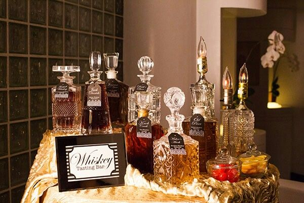 Fancy liquor bottles filled with lemonade, sweet tea, and water
