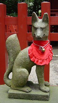 In the Shinto realm, the fox deity known as KITSUNE is often decked in red bibs. The fox is the messenger of Oinari, the deity of food, farmers, and the rice harvest.