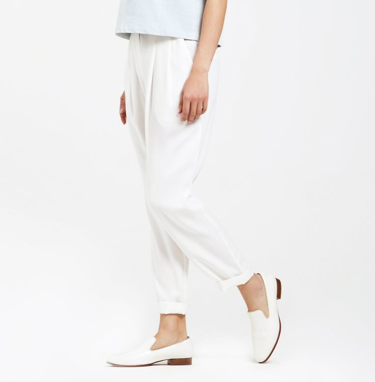 White trousers are the key staple of your summer wardrobe... a blank canvas ready to be dressed up. https://www.paisie.com/collections/new-in/products/peg-leg-trousers-with-d-ring-belt-in-white